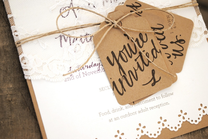 wedding invitation with lace and kraft tags
