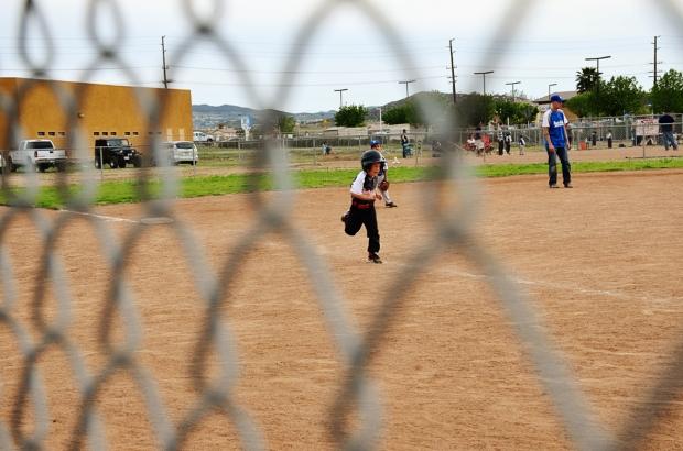 eli runs home baseball 505 e